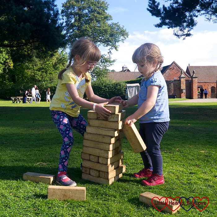 Jessica and Sophie playing giant Jenga at Baddesley Clinton