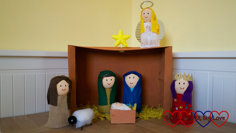 A Nativity scene in a shoebox showing Mary and Joseph with baby Jesus in the manger; a shepherd with his sheep; a King and an angel
