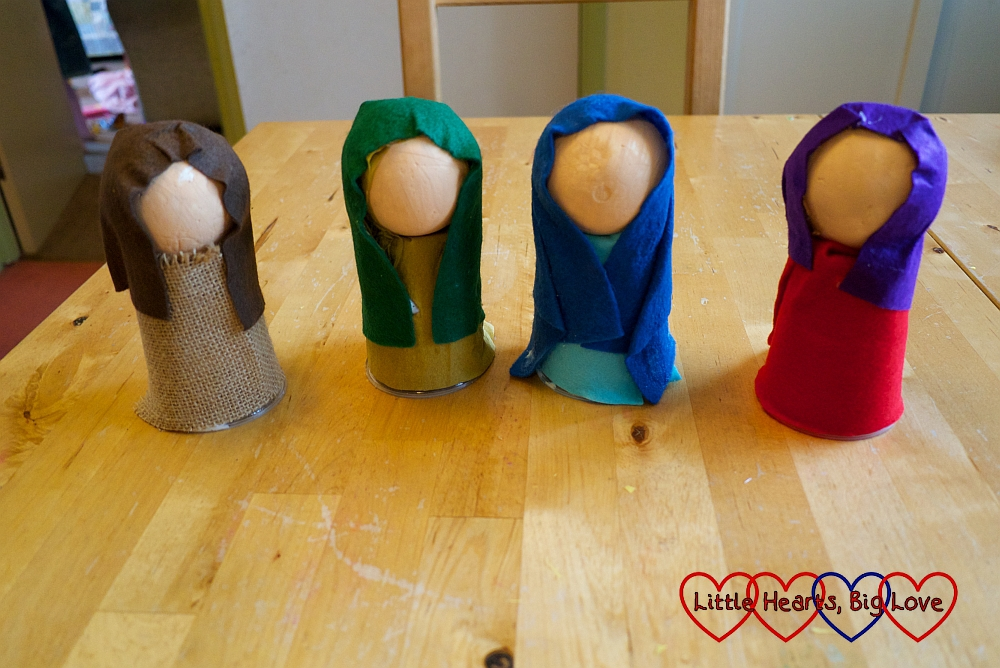 Four polystyrene figures with felt covered bodies and felt head coverings