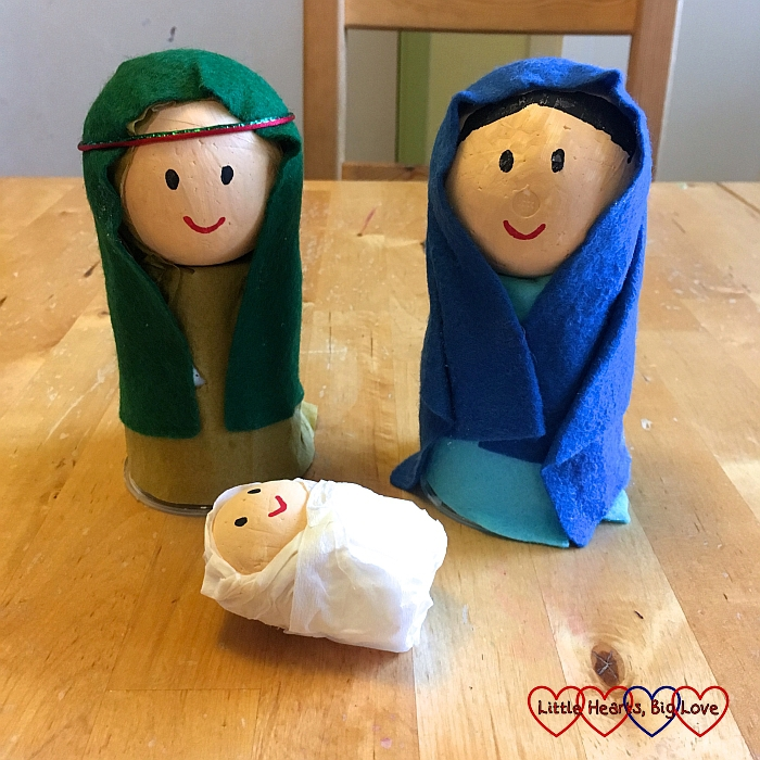 Mary and Joseph figures with baby Jesus figure