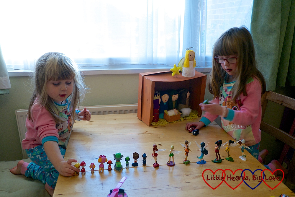 Jessica and Sophie recreating the Nativity story with Paw Patrol pups and fairies as extras