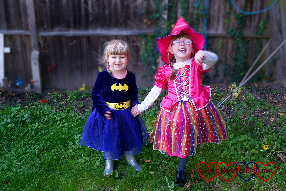 Jessica and Sophie wearing their Halloween costumes and holding hands