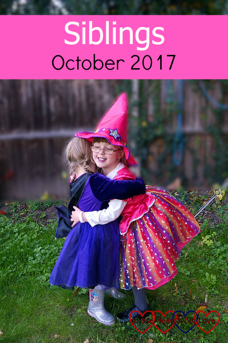 """Jessica and Sophie having a cuddle while wearing their Halloween costumes - """"Siblings - October 2017"""""""