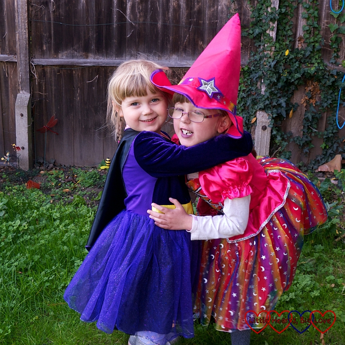 Jessica and Sophie having a cuddle in their Halloween costumes
