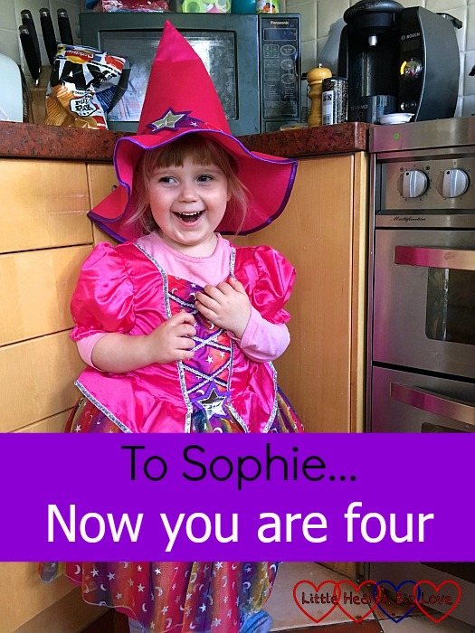 "Sophie wearing a pink witches' outfit - ""To Sophie... now you are four"""
