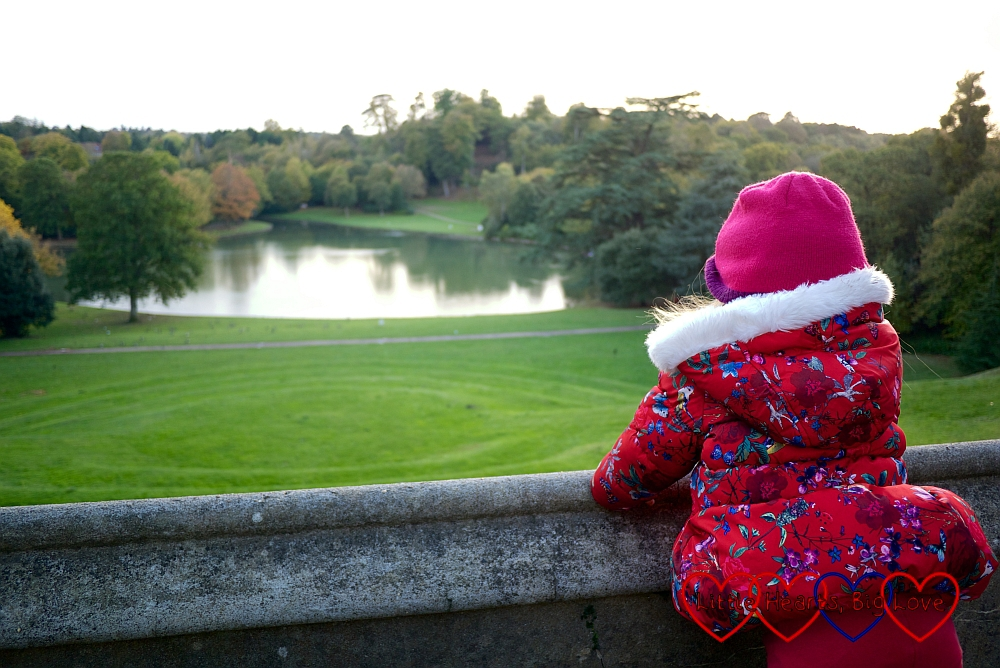 Sophie looking out at the lake from the mausoleum site at Claremont Landscape Garden