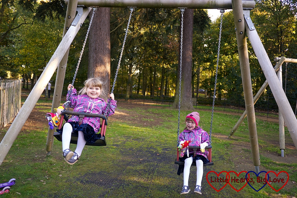 Jessica and Sophie having fun on the swings at Langley Park