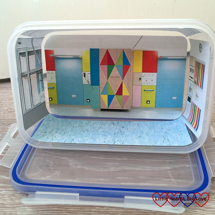 "A clip-lock box with pictures of a children's hospital interior stuck to the inside to make a ""children's hospital in a box"""