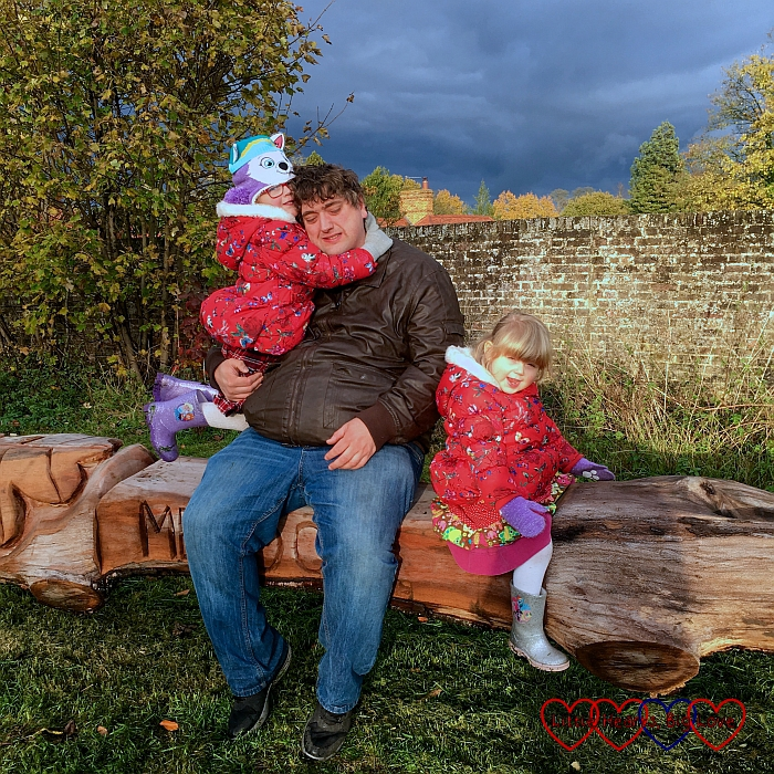 Hubby, Jessica and Sophie sitting on a bench in the autumn sunshine