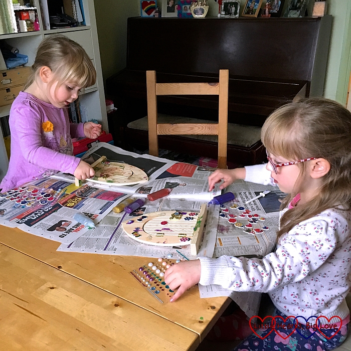 Jessica and Sophie decorating fairy doors