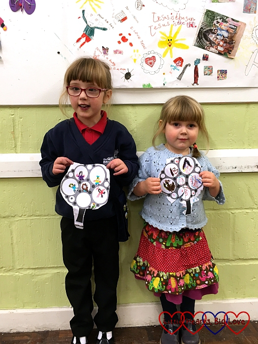 Sophie and Jessica holding their drawings that they did at Girls' Brigade