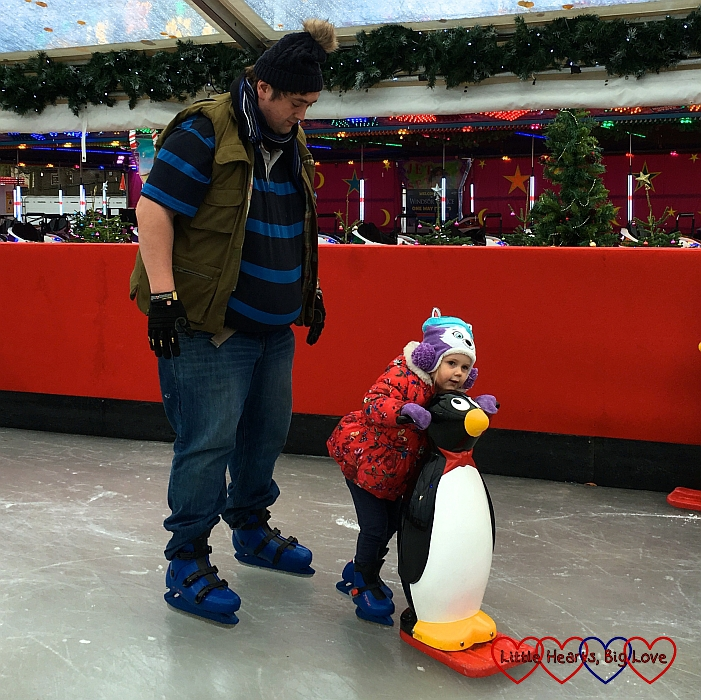 Hubby and Sophie on the ice rink at Windsor on Ice