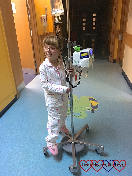 Jessica standing on her IV pole waiting for Mummy to push her around the ward