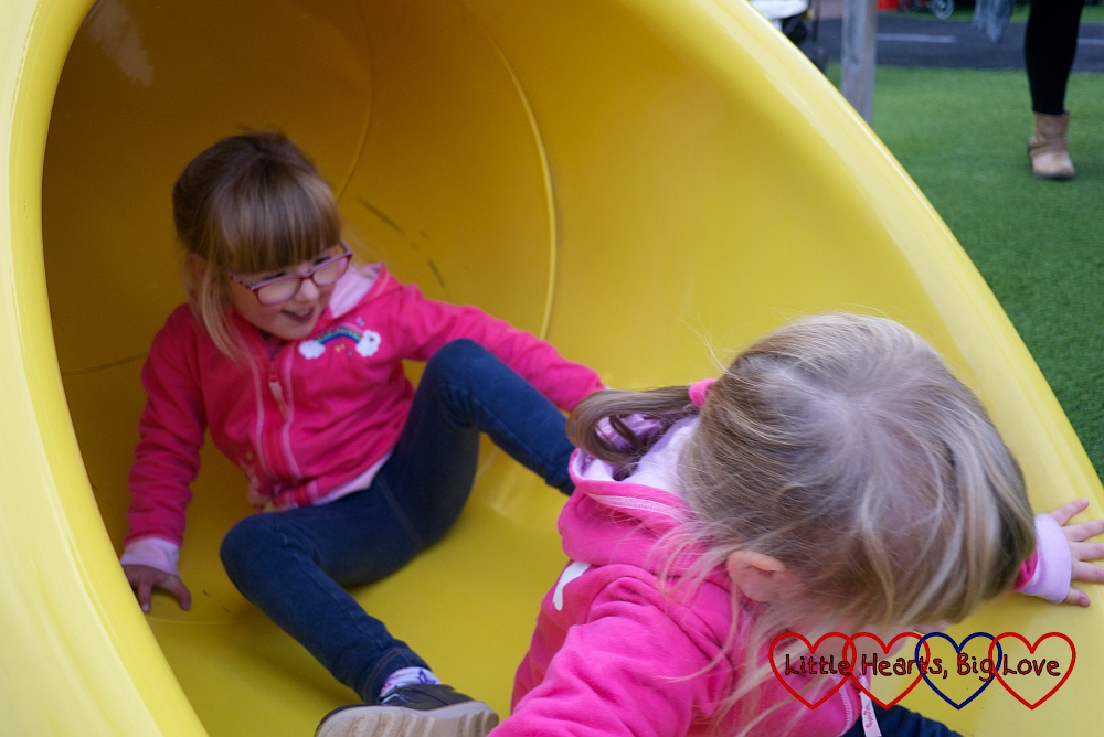 Jessica and Sophie going down the slide together