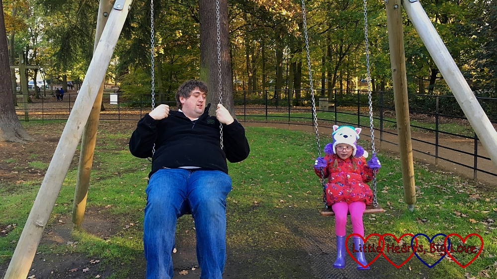 Hubby and Jessica on the swings at Langley Park