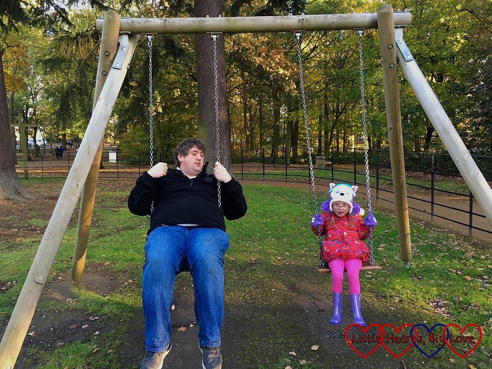 Hubby and Jessica on the swings together
