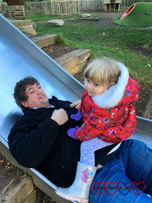 Hubby at the bottom of the slide with Sophie sitting on him