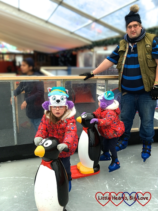 Sophie and Jessica with their penguin skate aids and hubby