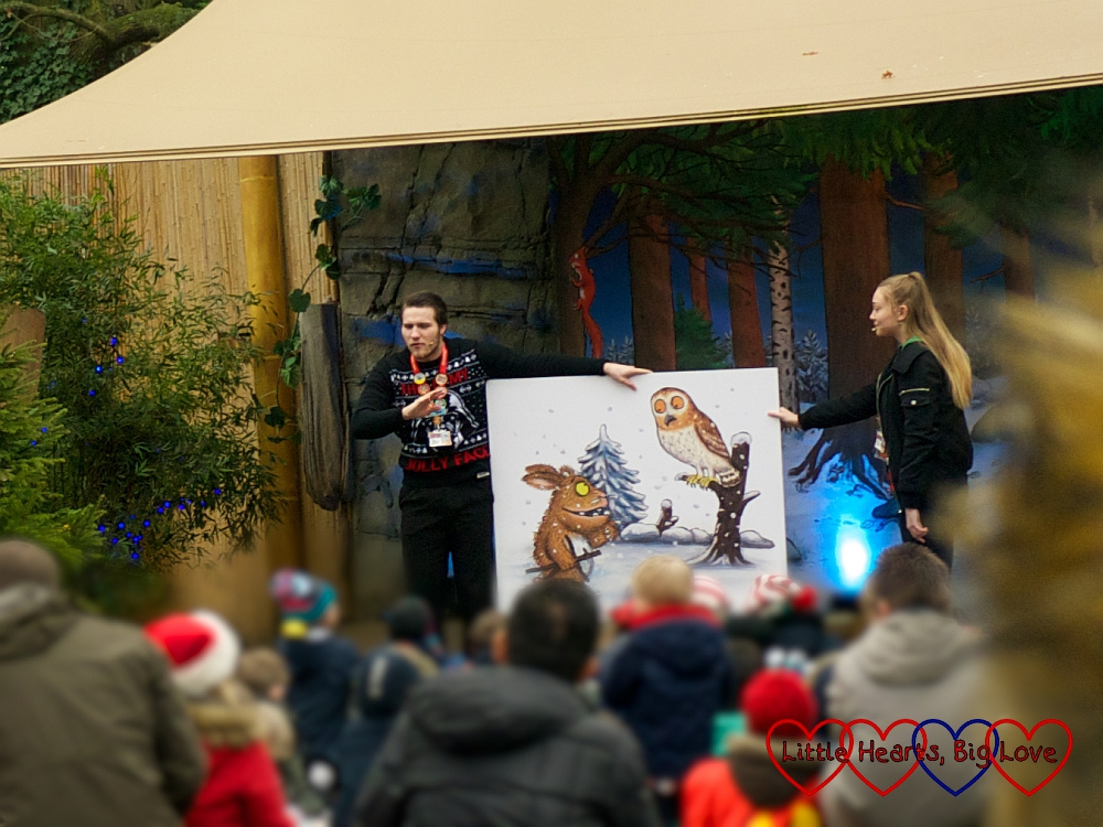 Two Chessington staff members holding a picture of the Gruffalo's Child and the Owl