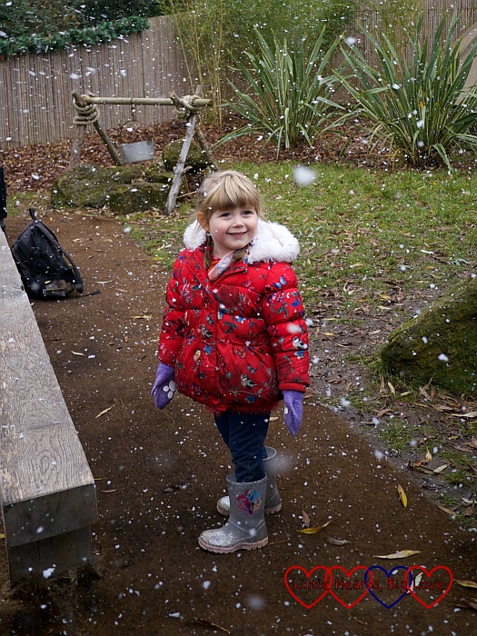 "Sophie enjoying the ""snow"" at Chessington World of Adventures"