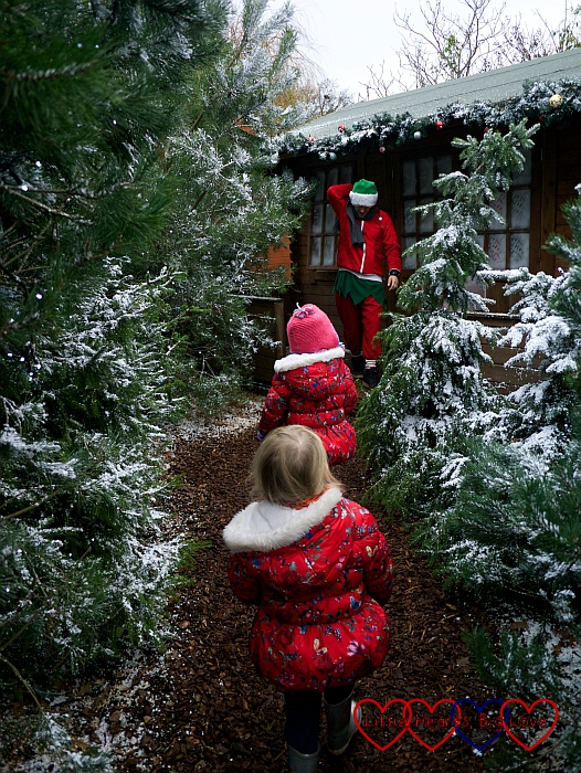 Jessica and Sophie are led through the snowy forest by Robin the Elf