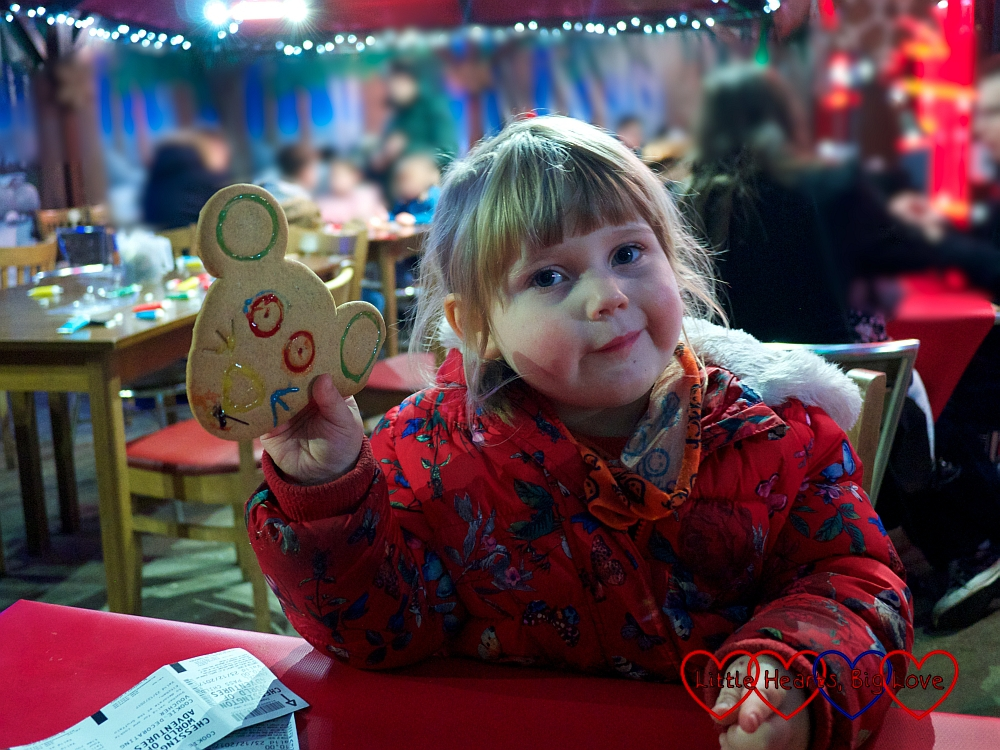 Sophie holding up her decorated cookie