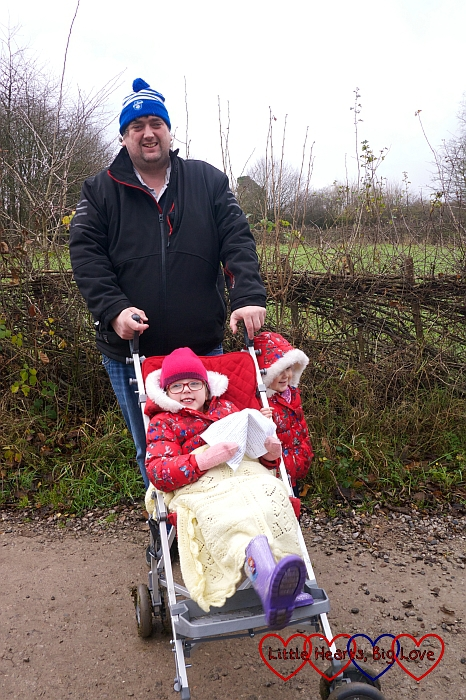 Hubby with Jessica in her buggy and Sophie standing next to her