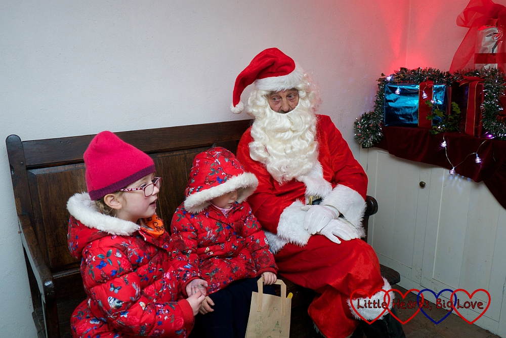 Sophie and Jessica meeting Father Christmas
