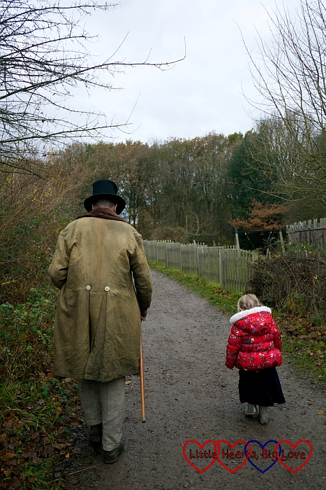 Sophie walking next to a man in Victorian costume