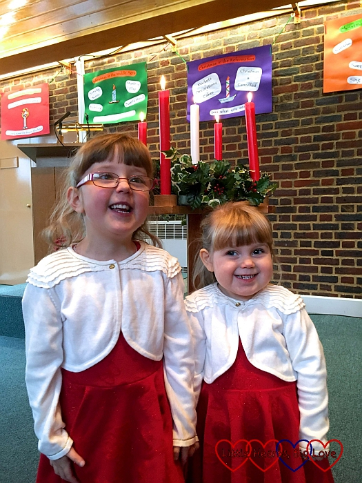 Jessica and Sophie standing in front of the Advent candles at church