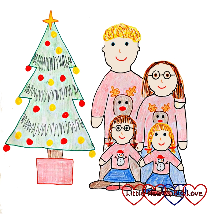 A drawing of me, hubby, Jessica and Sophie wearing Christmas jumpers and standing next to a Christmas tree