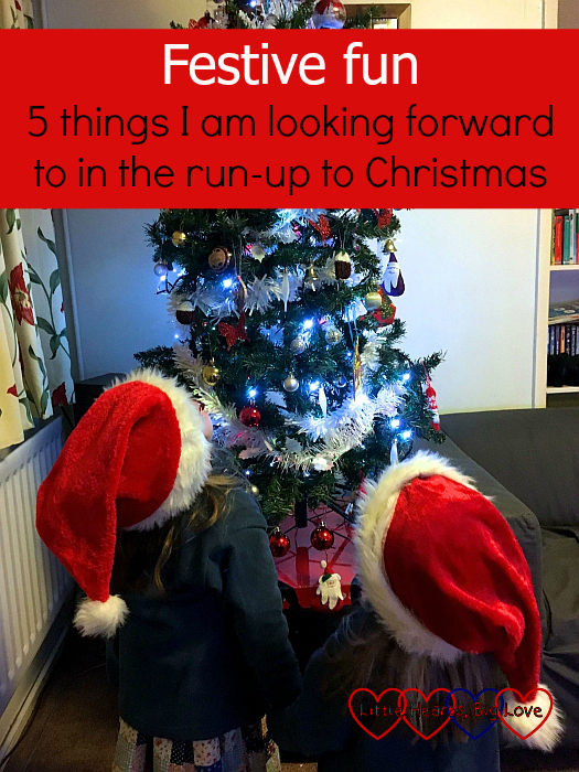 "Jessica and Sophie wearing Santa hats and looking up at the Christmas tree - ""Festive fun: 5 things I am looking forward to in the run-up to Christmas"""