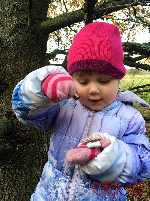 Sophie opening a geocache