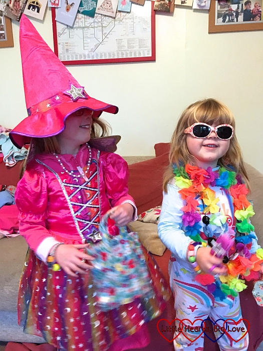 Jessica wearing a pink witch's outfit and Sophie wearing a lei and sunglasses