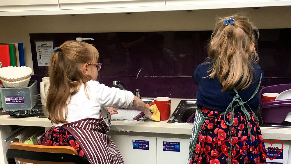Jessica and Sophie doing the washing up at church