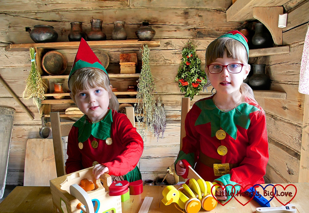 "Jessica and Sophie dressed as elves ""making"" wooden toys"