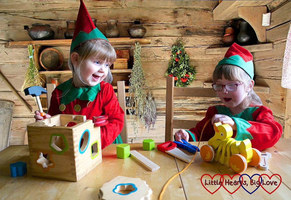"""Jessica and Sophie dressed as elves """"making"""" wooden toys"""