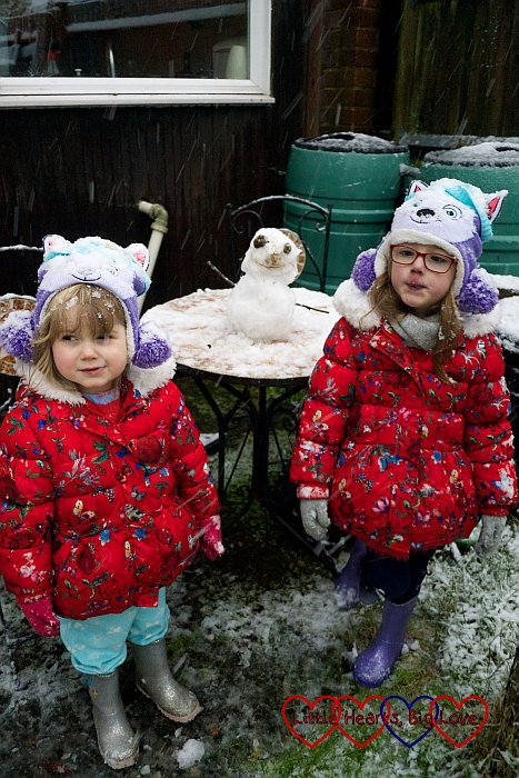Jessica and Sophie with their mini snowman