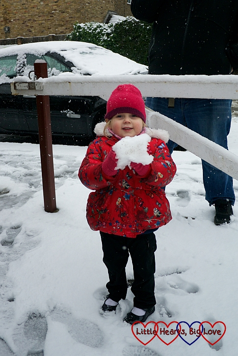 Sophie making a big snowball