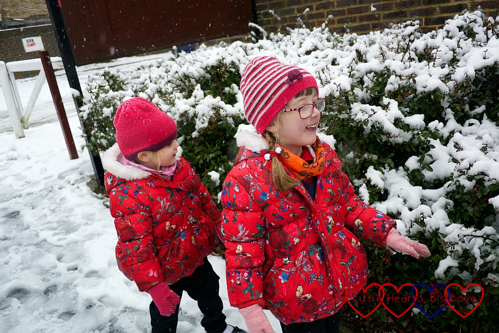 Jessica and Sophie next to snowy bushes