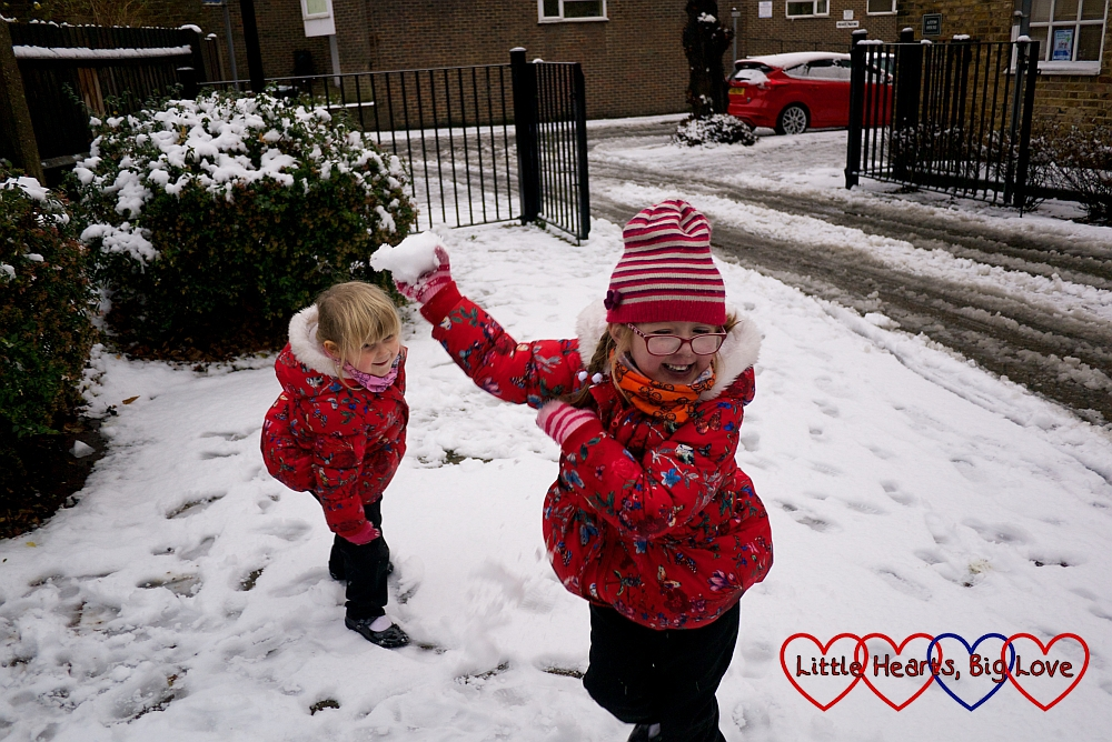 Jessica and Sophie playing outside in the snow