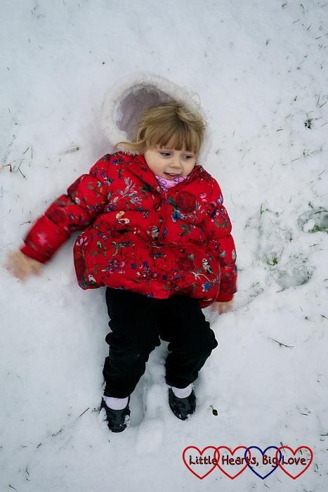 Sophie making snow angels