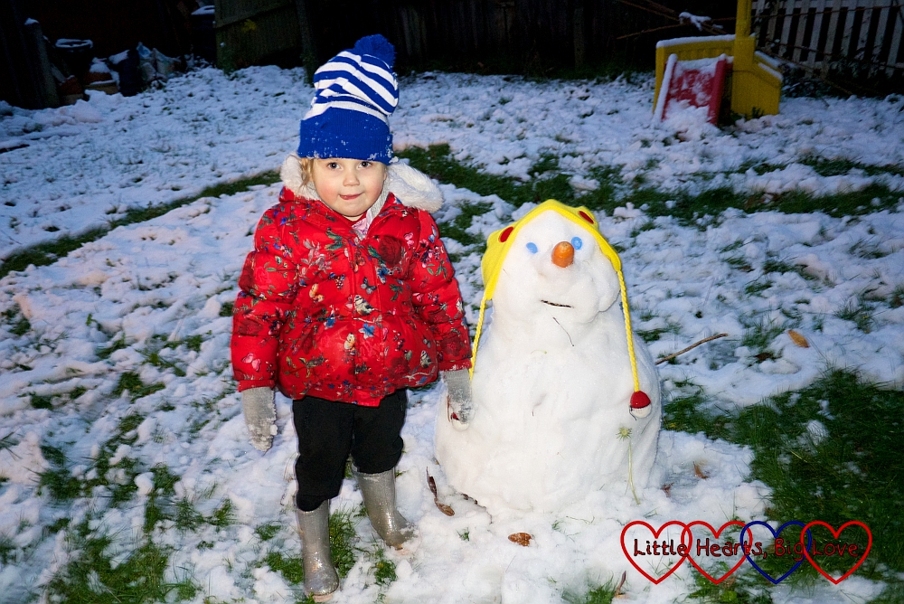 Sophie with her snowman
