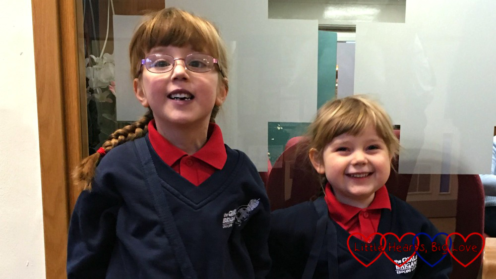 Jessica and Sophie at church in their Girls' Brigade uniforms