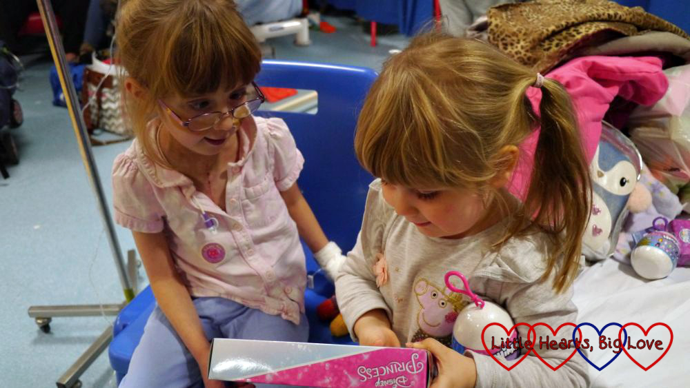 Jessica and Sophie looking at a toy together at the hospital