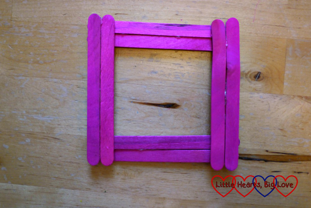 Eight craft sticks glued together in a square shape