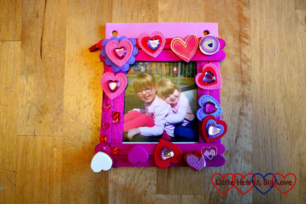 The craft stick photo frame with holes punched in the craft foam backing