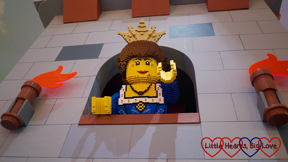 A Lego princess looking out of a castle window