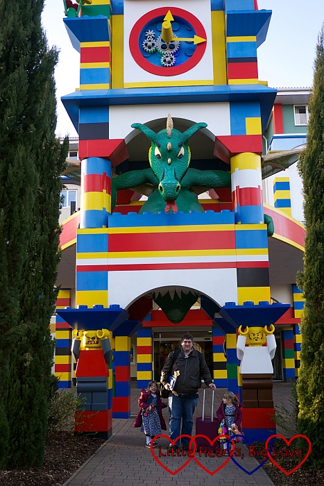 Hubby, Jessica and Sophie standing under the dragon at the entrance to the Legoland Hotel
