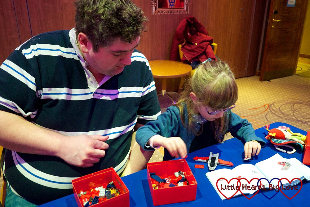 Jessica and hubby taking part in the Lego speed building session
